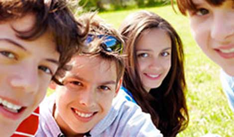 Students in a group smiling
